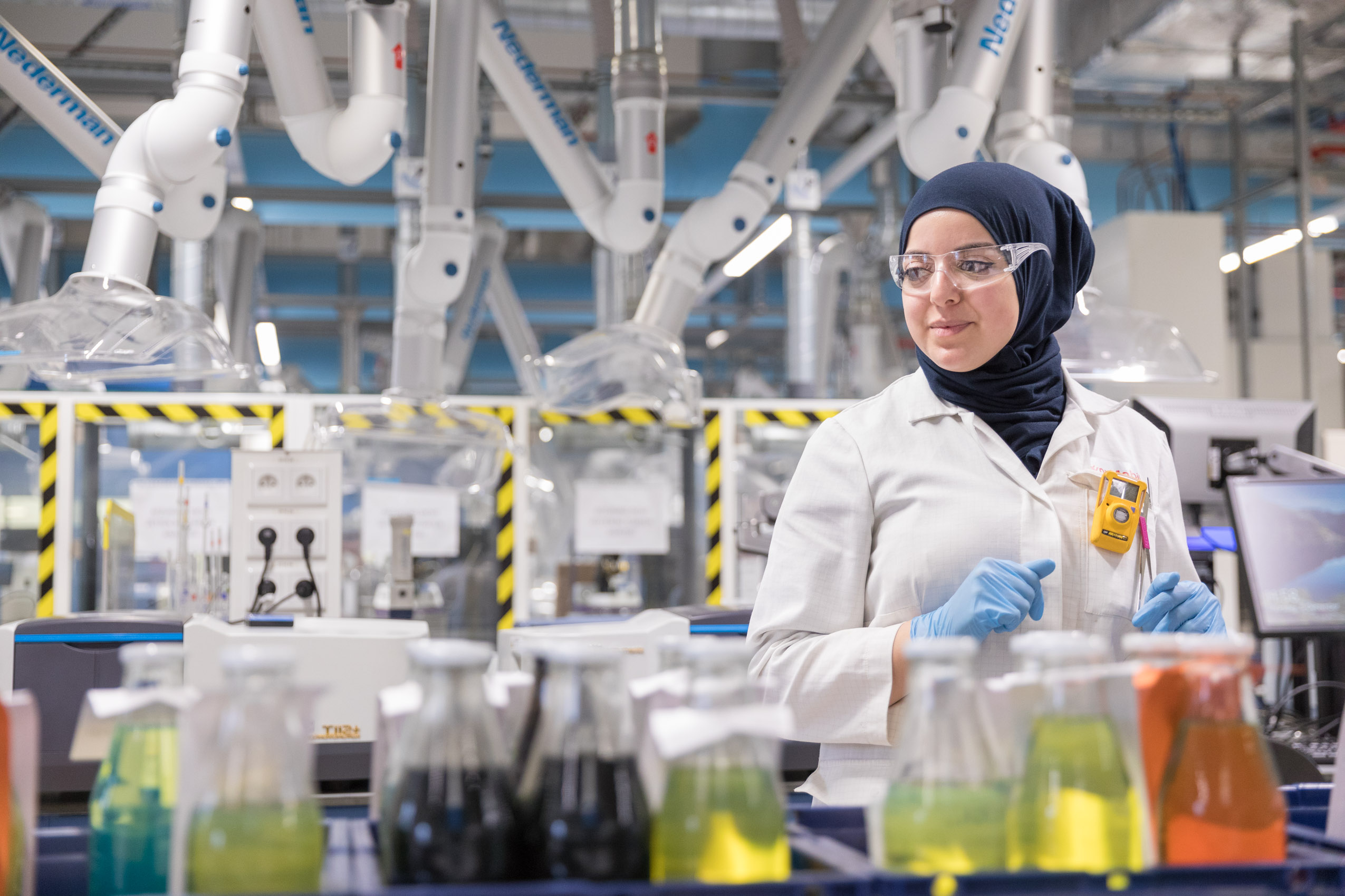 Energy and technology at laboratory with muslim female scientist by photographer Rich Crowder