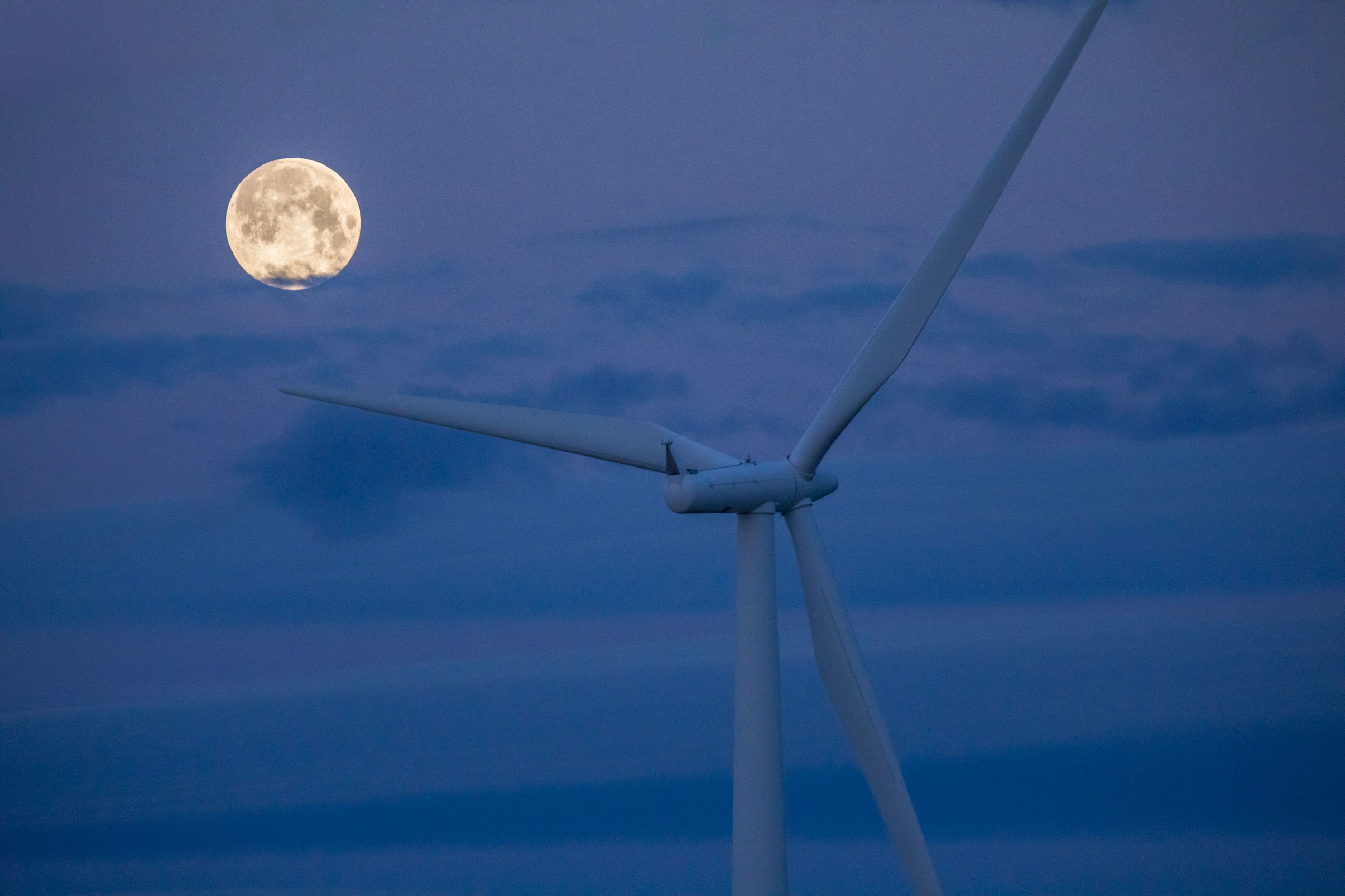 wind energy turbine with blue moon