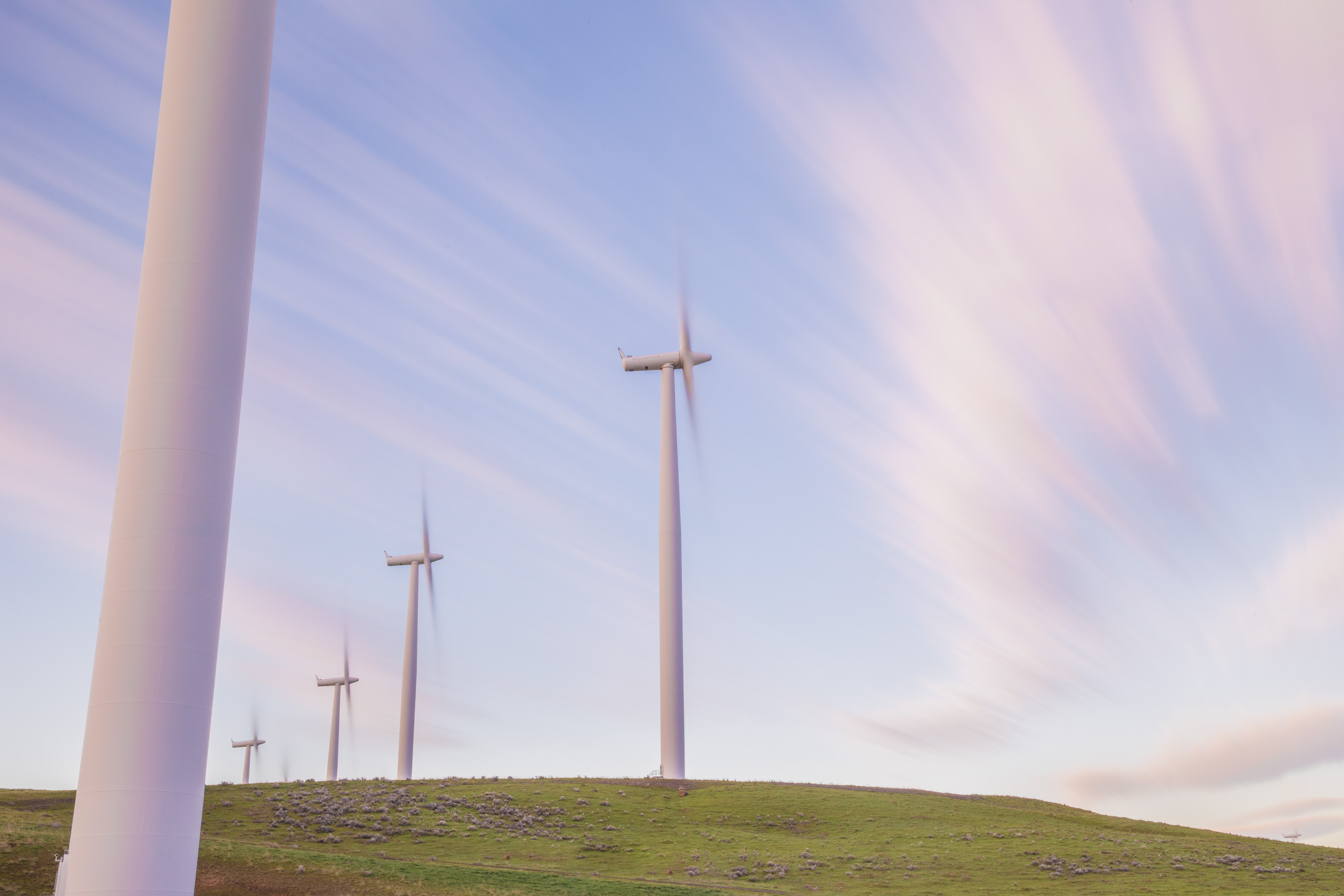 Renewable energy wind farm, wind turbines at sunrise by photographer Rich Crowder