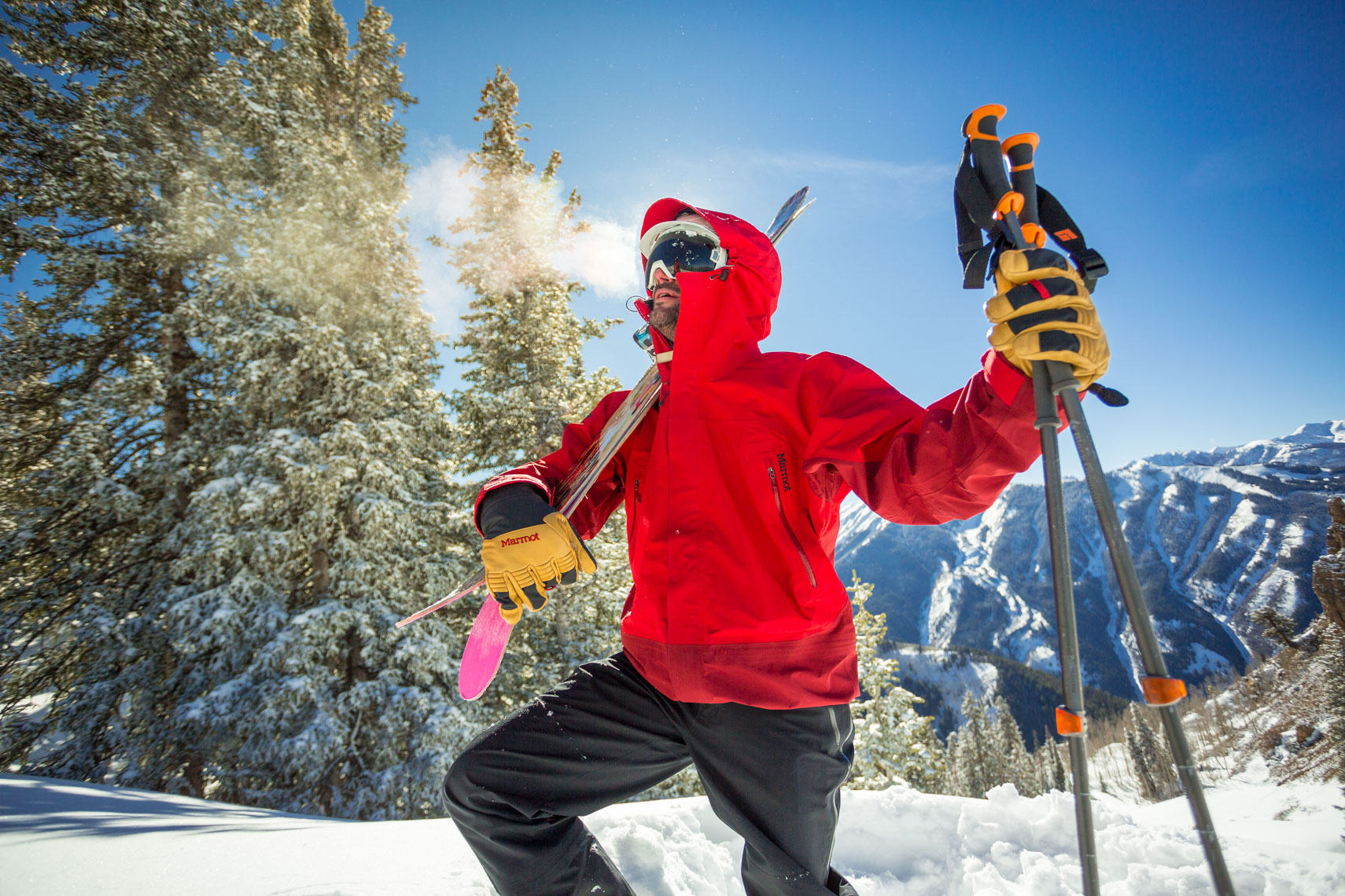 Skier in red jacket in Aspen by adventure photographer Rich Crowder