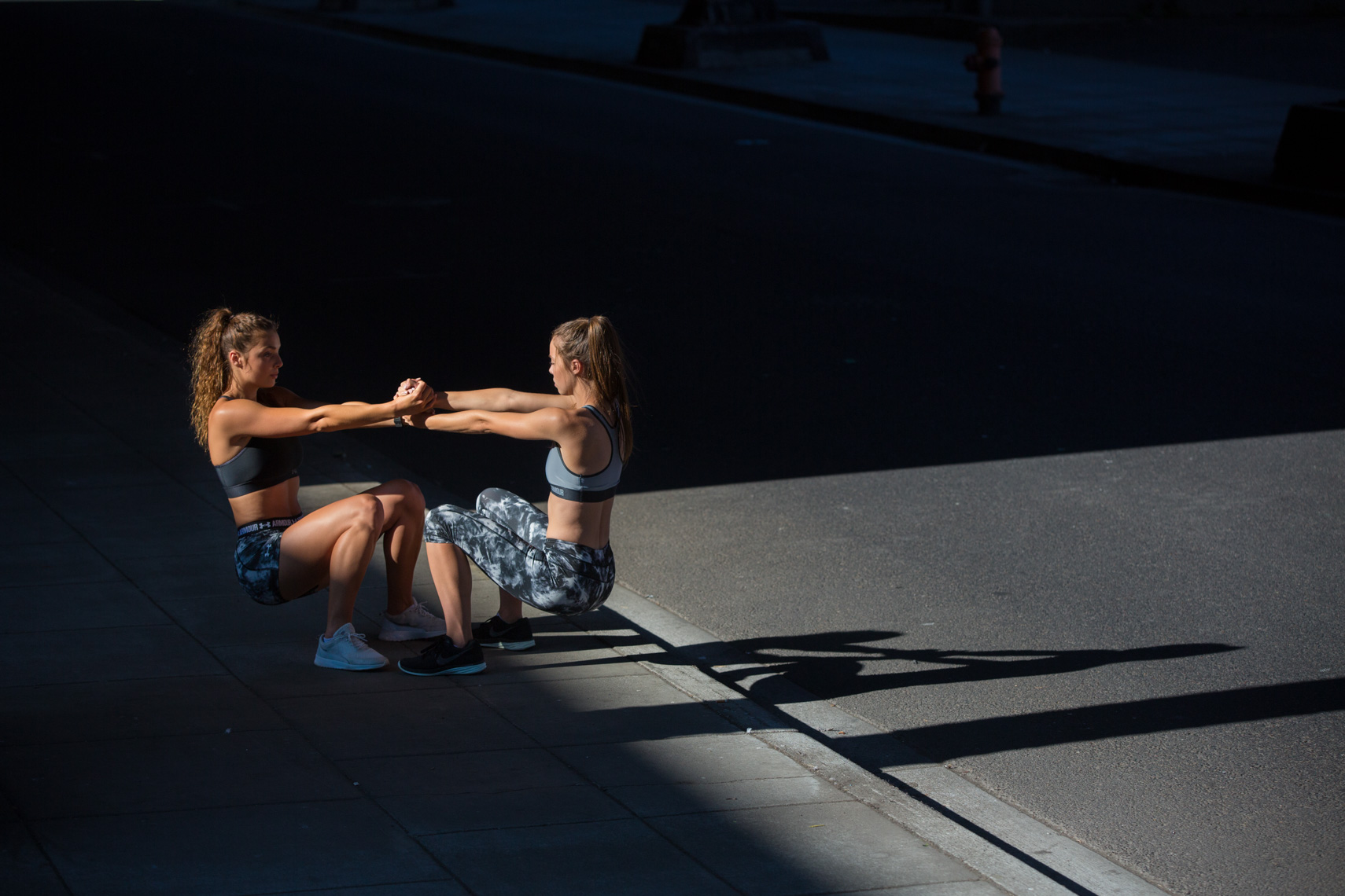 Two female athletes workout in urban setting Rich Crowder fitness Photographer