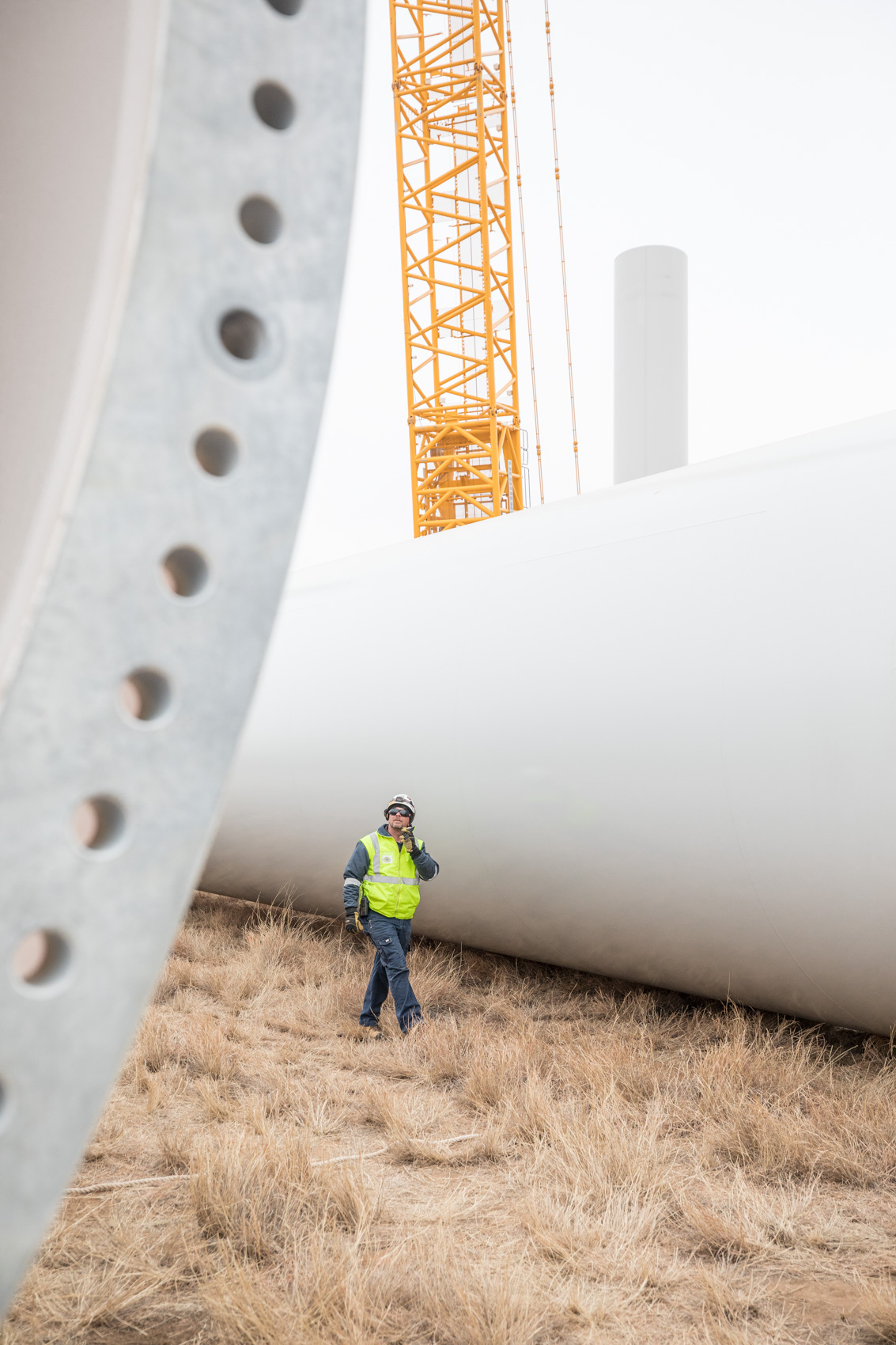 Wind turbine farm being build minimalist photography by Rich Crowder